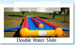 Double Water Slide Ages: 4-Adult   |   Size: 3 X 10M R600 Tuesday to Thursday R600 Friday to Monday